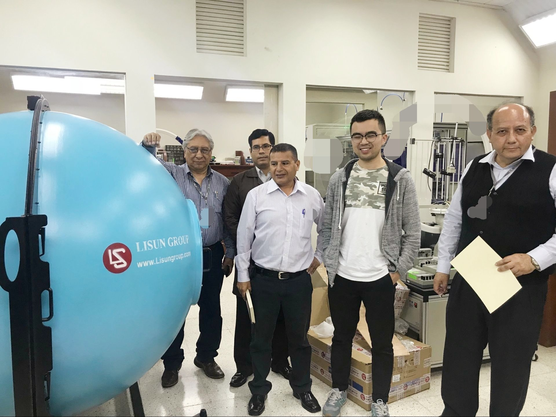 Figure 1: Group photo in front of LISUN LPCE-2 High Precision Spectroradiometer Integrating Sphere System